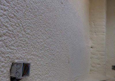 Isolation projetée : réalisation de l'isolation d'un mur à Liège